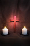 Crucifix and Two Candles Stock Photos