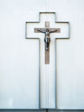 Crucifix on a wall of a house Stock Photos