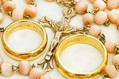 Crucifix and wedding rings. Collar with crucifix and wedding rings Royalty Free Stock Image