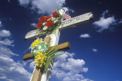 Crucifixes adorned with flowers Royalty Free Stock Images
