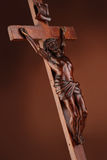 The crucifixion. Wooden sculpture on dark background Royalty Free Stock Images