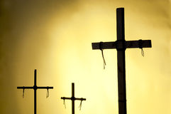 The Crucifixion. Shadow and silhouette of the crucifixion on a yellow background stock images