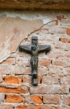 Crucifixion. Cross with a crucifixion on a brick wall Royalty Free Stock Photo