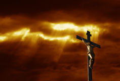 Crucifixion. Of jesus Christ with dramatic red sky Stock Photos