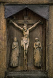 Crucifixion of Christ carved on ancient icon. Crucifixion of Christ carved on ancient wooden icon. The wooden figure of the Crucifixion of Christ. Old wooden Stock Image