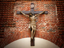 Crucifixion of Christ on a stone wall. Crucifixion of Christ in the old red brick masonry Royalty Free Stock Photos
