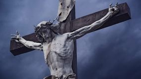 Crucifixion. Christian cross with crucified Jesus Christ statue over dark clouds time lapse. stock video footage
