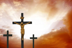 Crucifixion.Christian cross on dramatic red cloudscape Royalty Free Stock Photography