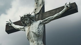 The Crucifixion. Christian cross with Jesus Christ crucified statue over stormy clouds time lapse. stock video footage