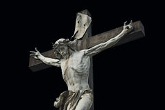 Crucifixion. Christian cross with Jesus Christ statue isolated o Royalty Free Stock Images