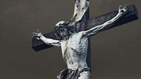 Crucifixion. Christian cross with Jesus Christ statue over storm stock video footage