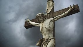Crucifixion. Christian cross with Jesus Christ statue stock video footage