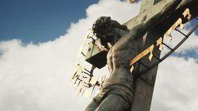 Crucifixion. Christian cross with Jesus Christ statue over stormy clouds time lapse. stock footage