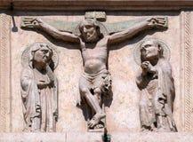 Crucifixion. Relief on Facade of Saint Anastasia Church in Verona, Italy stock photography