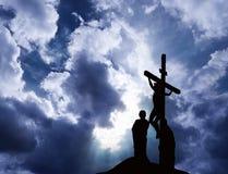 Crucifixion of Jesus. On stormy sky stock image