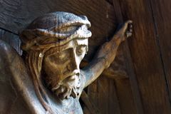 Crucifixion of jesus christ. The crucifixion of jesus christ on the cross by a monument royalty free stock photos