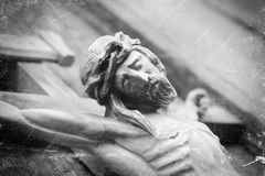 Crucifixion of Jesus Christ as a symbol of resurrection and immortality of the human soul. Retro styled old wooden statue.  royalty free stock images