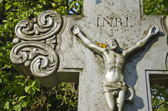 Crucifixion, Jesus Christ on cross in cemetery Stock Photos