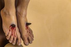 Crucifixion of Jesus Christ. Nailed feet, detail of sculpture of the Crucifixion of Jesus Christ Stock Photo