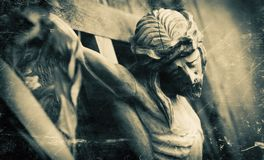 Crucifixion of Jesus Christ. Retro styler old wooden statue.  royalty free stock photography