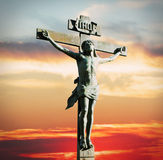 Crucifixion of Jesus Christ on the sunset. In the sky Stock Photos