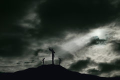 Crucifixion of Jesus on Golgotha With Copy Space. A depiction of the crucifixion of Jesus Christ on a cross with 2 other robbers nearby on Calvary. The sky is Royalty Free Stock Photo