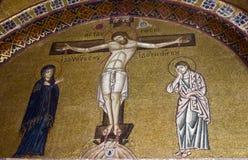 Crucifixion of Jesus, mosaic. Crucifixion of Jesus, 11th century mosaic, Monastery Hosiou Louka, Greece stock photo