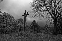 Crucifixion portrayed in bleak landscape. Jesus Christ suffering on the cross. Life-sized depiction outside on a hill in a bleak landscape. Scenery in German Royalty Free Stock Images
