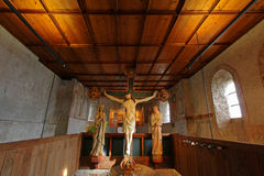 The Crucifixion scene at Tyrol Castle (Schloss Tirol), Italy. The Crucifixion scene, circa 1330, with Christ on the Cross and 2 figures of Mary and John in Royalty Free Stock Image