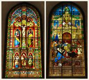 Crucifixion in the stained-glass window. Two stained glass pictures шт a window of a cathedral: crucifixion of christ in the stained-glass, and a bed of a Stock Image