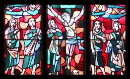 Crucifixion, stained glass window in Basilica of St. Vitus in Ellwangen, Germany.  stock photo
