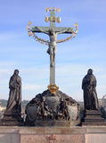 Crucifixion, statue with Hebrew lettering in Charles Bridge Prague, Czech Republic Stock Images