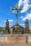 Crucifixion, statue with Hebrew lettering in Charles Bridge Prague, Czech Republic Stock Photo