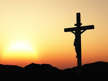 Crucifixion and sunset Stock Image