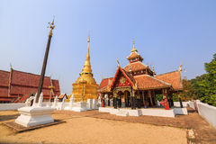 Cruciform shaped pavilion and golden Buddhist pagoda Royalty Free Stock Photos