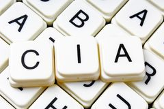 Crucigrama de la palabra del texto de la Cia Fondo de la textura del juego de los bloques de la letra del alfabeto Fotografía de archivo libre de regalías