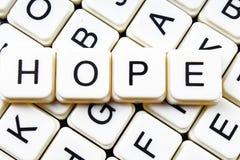 Crucigrama de la palabra del texto de la esperanza Fondo de la textura del juego de los bloques de la letra del alfabeto Fotografía de archivo