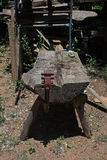 CRUDE BACKYARD WORKBENCH. Large split log used for outdoors workbench Royalty Free Stock Photography
