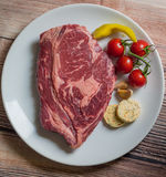 Crude  beef meat on a white plate Royalty Free Stock Images