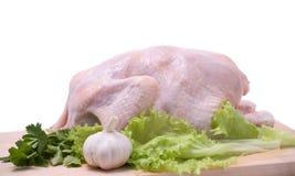 Crude chicken on chopping board Stock Photos