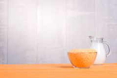 Crude corn grits on the board diet food Stock Images