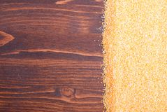 Crude corn grits on the board diet food Royalty Free Stock Images