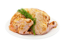 The crude cut chicken on a white plate Royalty Free Stock Image