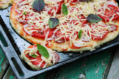 Crude homemade pizza, close-up Stock Images