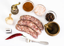 Crude homemade sausage with spices Stock Images