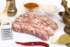 Crude homemade sausage with spices Royalty Free Stock Photo
