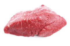 Crude meat. Piece of fresh crude meat on a white background Royalty Free Stock Photos