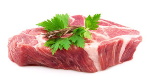 Crude meat. With parsley and  rosemary Royalty Free Stock Photography