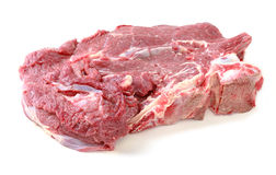 Crude meat. On a white backgrounds Royalty Free Stock Photos