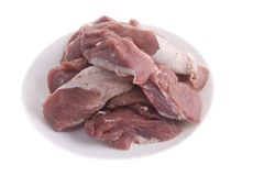 Crude meat on a plate Royalty Free Stock Images